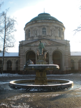 A snow-covered fountain in front of the Vierortbad