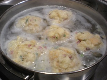 Semmelknödel floating in water while I telepathically beg them not to fall apart...