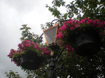 A lantern on the bridge right next to the sandwich shop