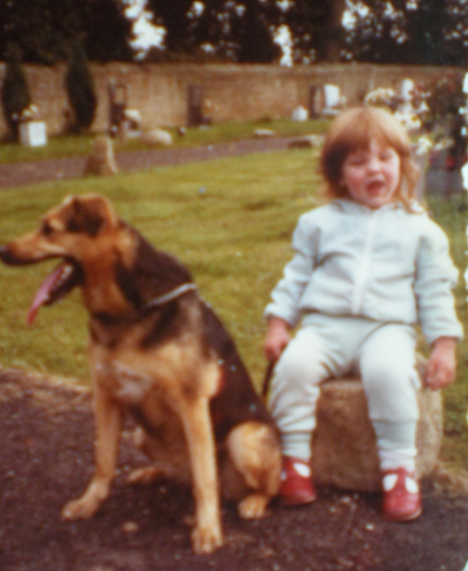 Me, aged 3 or 4, with my grandma's dog