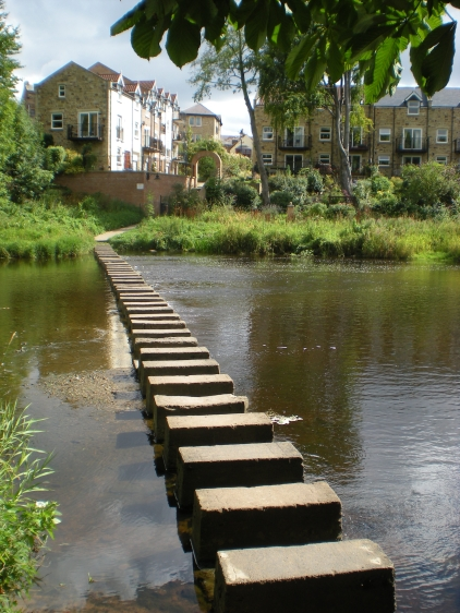 Stepping stones crossing the River Wansbeck in Morpeth