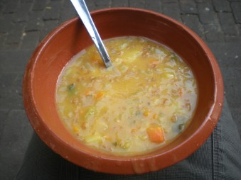 A soup consisting of vegetables, barley and pieces of pork