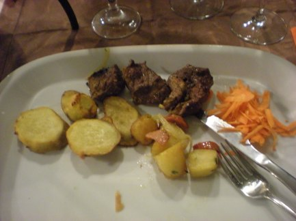 Meat from the skewer with sweet potatoes... apparantly sweet potatoes are a popular side dish there