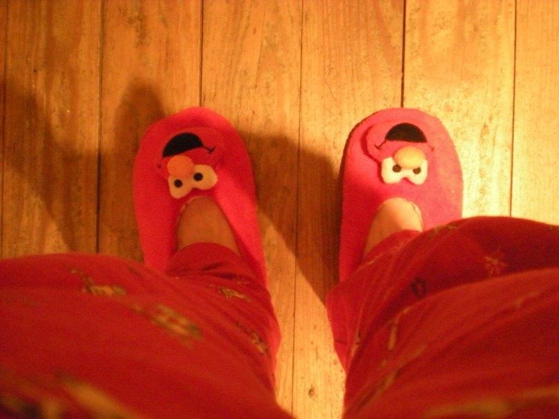 Elmo slippers and red pyjamas