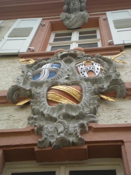 An interesting coat of arms on the side of a building