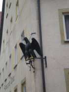 "The writing on the building says ""Schwarzer Adler"", Black Eagle"