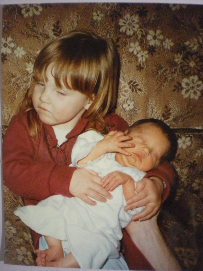 Me aged 2 and  a half with my baby sister
