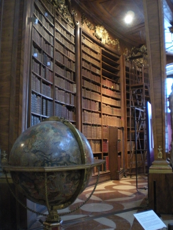 Books and a globe in the Prunksaal