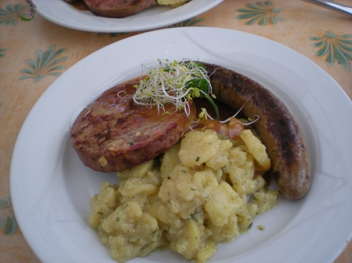 Wild boar sausage, wild boar Saumagen and potato salad