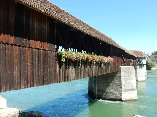 Wooden bridge... Switzerland over on the other side!