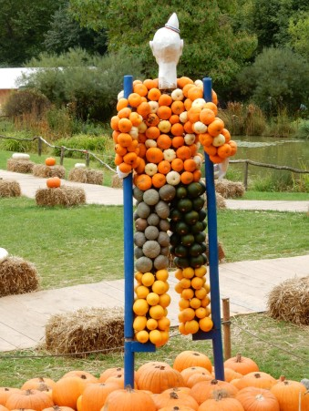 Pumpkin clown on stilts