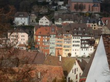 The roofs at the front are in Laufenburg, Switzerland. The sunlit buildings at the back are in Laufenburg, Germany.